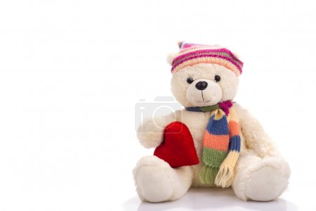 Toy teddy bear sitting with valentine heart
