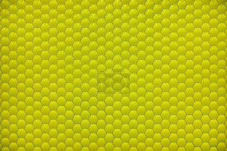 Yellow shiny hexagon bubble tile texture background