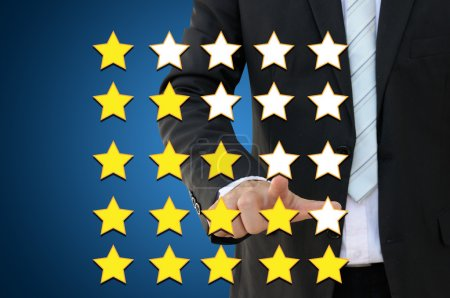 Photo for Business hand pointing performance evaluation in rating concept - Royalty Free Image