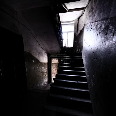 Photo for Old staircase in dramatic light - Royalty Free Image