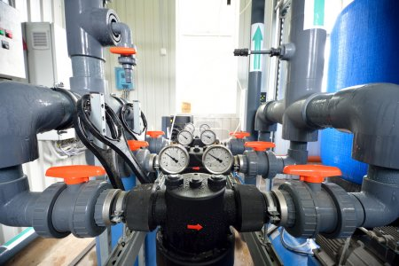 Industrial barometers and water pipes and tnaks in boiler room