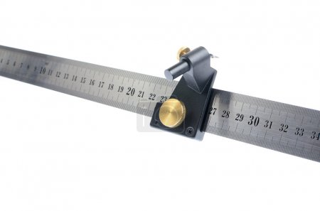 metal ruler with mesuring instruments on it isolated