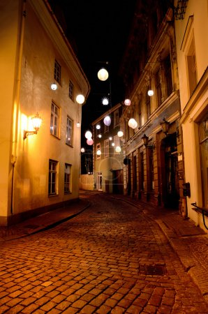 Narrow street in Old Riga with lanterns