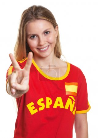 Spanish sports fan showing victory sign