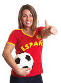 Spanish girl with football showing thumb up