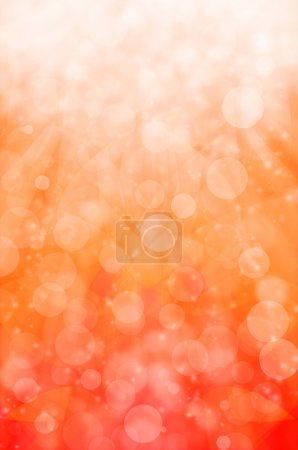 abstract light bokeh on orange background.