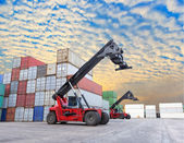 Crane lifting at container yard with beautiful sky