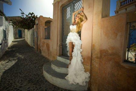 beautiful woman in a crystal dress in Santorini