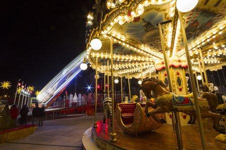 Luna park carousel in a public outdoor area