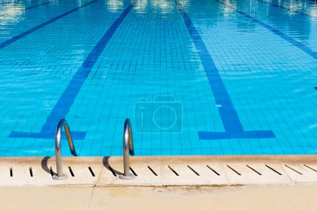 Photo for Swimming pool with stair and sunny reflections - Royalty Free Image