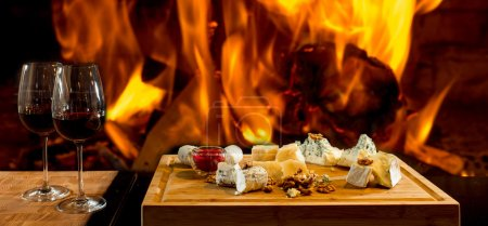 Photo for Delicious cheese and wine at the fireplace - Royalty Free Image