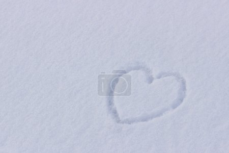 Small pictured heart on the snow