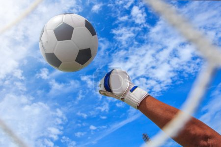 Photo for Soccer ball in goal with loss goalmam - Royalty Free Image