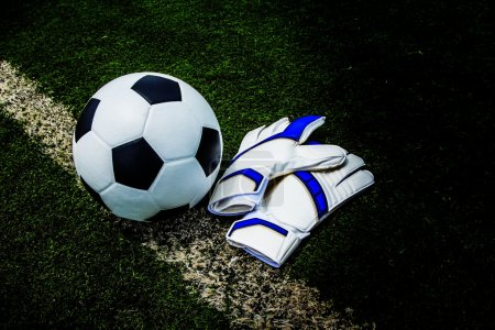 Soccer ball and gloves