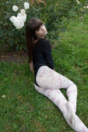 Girl and roses in botanical garden
