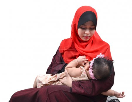 Young Asian muslim mother breastfeeding her cute baby girl isolated on white background