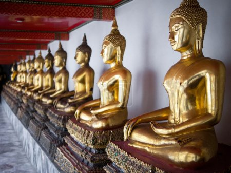 Photo for Row of Buddha Statues lined up at Wat Pho temple in Bangkok, Thailand. - Royalty Free Image