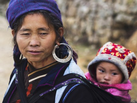 Hmong Woman Carrying Child and Wearing Traditional Attire, Sapa,