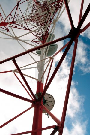 Red and white tower of communications with their a...