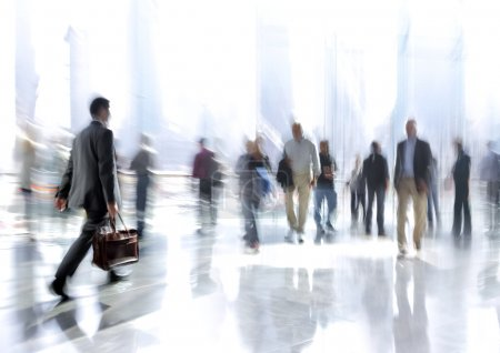 Photo for Abstakt image of people in the lobby of a modern business center with a blurred background - Royalty Free Image