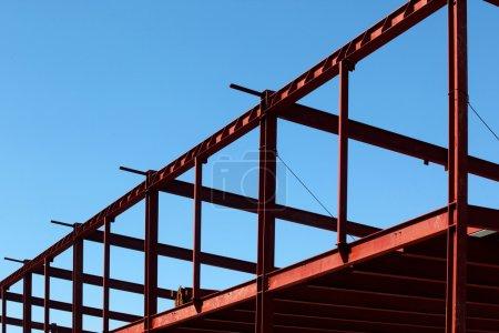 Steel beams against the blue sky.