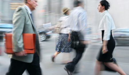 Photo for Business people at rush hour walking in the street, in the style of motion blur - Royalty Free Image