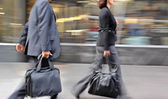 """Постер, картина, фотообои """"motion blurred business people walking on the street"""""""
