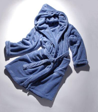 It is a blue terry bathrobe.