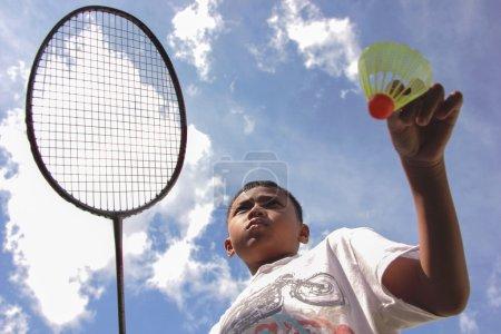 asian badminton boy with sunshine