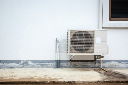 Air conditioner on the wall of boards.