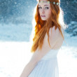 Snow Maiden. Fantasy image of beautiful red head w...