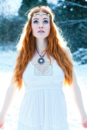 Snow Maiden. Whimsical image of beautiful red head...