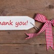 Thank you message with pink bow on the wooden back...