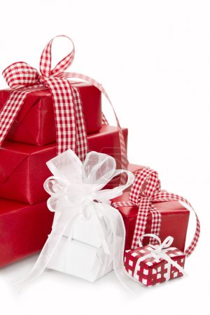 Presents wrapped in red and white paper