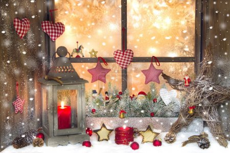Photo for Red Christmas decoration with lantern on window sill - Royalty Free Image