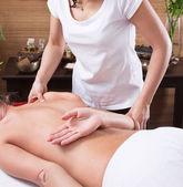 Hands of a woman making massage