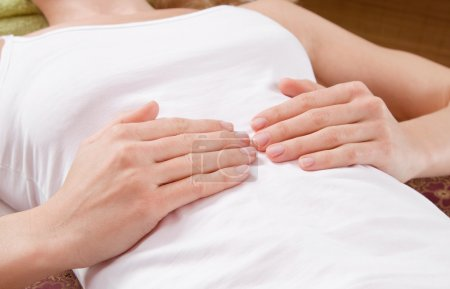 Photo for Hands of lying woman on her belly during massage - traditional thai massage - Royalty Free Image