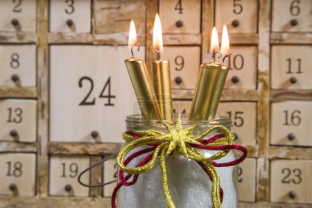 Shabby calendar with burning candles