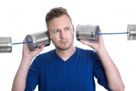 Man holding tin can phones