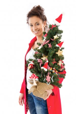 Woman with Christmas tree
