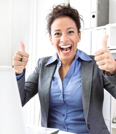 Laughing woman thumbs up