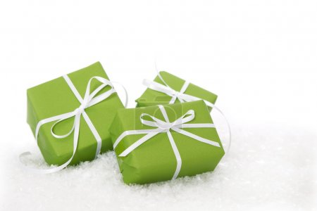 Green gift box tied with white ribbon - present isolated for christmas