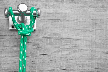 Photo for Maritime wooden background - scenery with green rope - Royalty Free Image