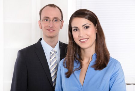 Business teamwork - man and woman on white with blue