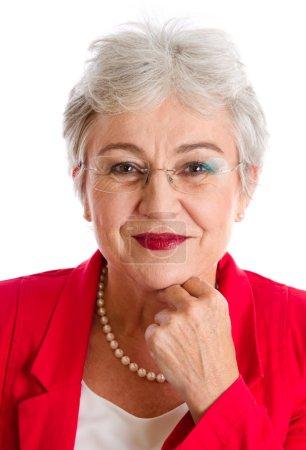 Serious elderly woman