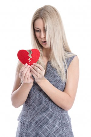 Photo for Sad blond caucasian woman holding broken red heart - love sickness - isolatede on white. - Royalty Free Image