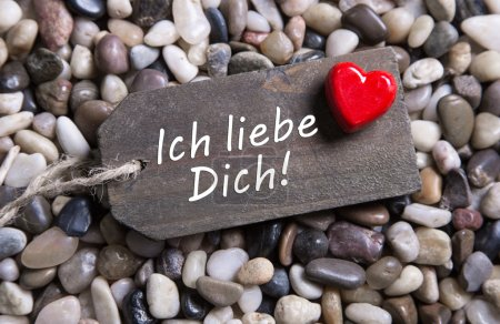 I love you card with german text and a red heart on a wooden sig