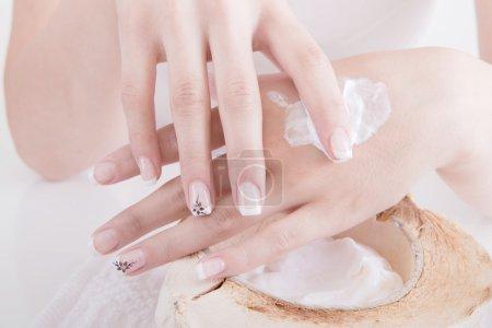 Woman applying hand lotion...