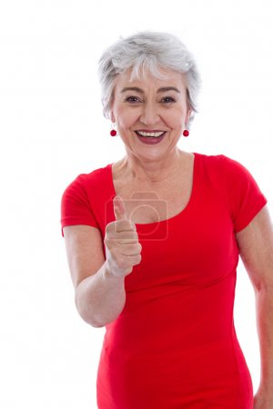 Photo for Powerful and successful older woman - thumbs up isolated on white background. - Royalty Free Image