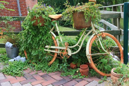 Garden decoration with a old bike.